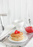 Stack of pancakes. On a silver tray with red berries stock photos