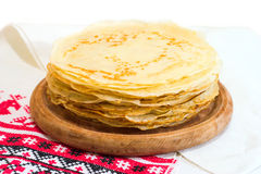 Stack of pancakes. On a wooden plate Royalty Free Stock Photo