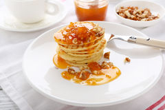 Stack of pancakes with apricots Royalty Free Stock Images