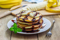 Stack of pancakes with banana and chocolate syrup Royalty Free Stock Image