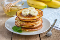 Stack of pancakes with banana and honey Stock Photos