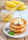 Stack of pancakes with banana and honey Royalty Free Stock Photo