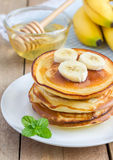 Stack of pancakes with banana and honey Royalty Free Stock Images