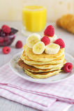 Stack of pancakes with berries, croissant, juice Stock Photos