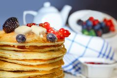A stack of pancakes with blueberry and currant and blackberry stock photos