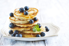Stack of pancakes with blueberry and honey. royalty free stock image