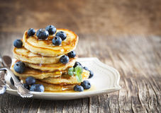 Stack of pancakes with blueberry and honey Royalty Free Stock Photography