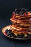 Stack of pancakes with blueberry jam and berries on the wooden table Royalty Free Stock Photography