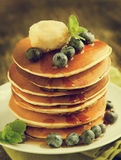 Stack of pancakes with blueberry,maple butter and syrup Royalty Free Stock Image