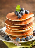 Stack of pancakes with blueberry and maple syrup Stock Photos