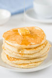 Stack of pancakes with butter and honey Royalty Free Stock Photos