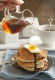 Stack of pancakes with butter and maple syrup Royalty Free Stock Photography