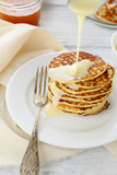 Stack of pancakes with condensed milk Stock Image