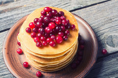 A stack of pancakes with cranberries Royalty Free Stock Photos