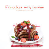 Stack of pancakes with cream, fruit sauce and berries, isolated Royalty Free Stock Photos