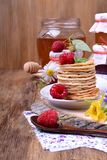 Stack of pancakes decorated with raspberry and mint stock photography