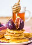 Stack of pancakes with figs and honey Stock Photography