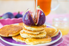 Stack of pancakes with figs and honey Stock Photos