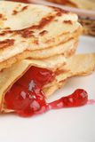 Stack of pancakes filled with red jam. Closeup stack of pancakes filled with red jam Stock Image