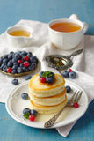Stack of pancakes with fresh berries and honey Royalty Free Stock Photo