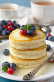 Stack of pancakes with fresh berries and honey Royalty Free Stock Photos