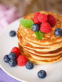 Stack of pancakes with fresh berries Royalty Free Stock Image