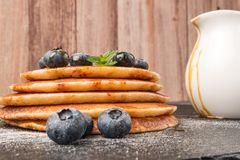 Stack of pancakes with fresh blueberry and caramel syrup.  Stock Image