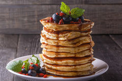Stack of pancakes with fresh blueberry, goji and maple syrup. Stack of pancakes with fresh blueberry, goji berries and maple syrup stock images
