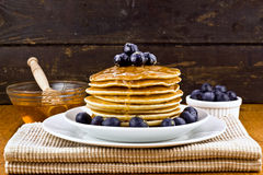 Stack of pancakes with fresh blueberry and honey Royalty Free Stock Image
