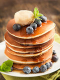 Stack of pancakes with fresh blueberry,maple butter and syrup Stock Photos
