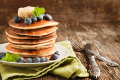 Stack of pancakes with fresh blueberry,maple butter and syrup on stock photo
