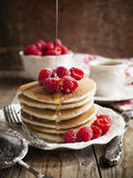 Stack of pancakes with fresh raspberries. Stack of pancakes with fresh raspberries on plate Royalty Free Stock Images