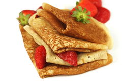 Stack of pancakes with fresh strawberries Royalty Free Stock Images