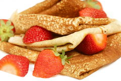 Stack of pancakes with fresh strawberries Stock Images