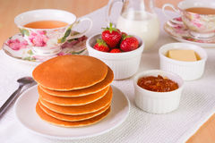 Stack of pancakes with fresh strawberries, butter, marmelade an Stock Photo