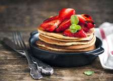 Stack of pancakes with fresh strawberry and balsamic glase. Royalty Free Stock Photo