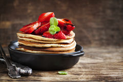 Stack of pancakes with fresh strawberry and balsamic glase Royalty Free Stock Image