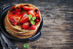 Stack of pancakes with fresh strawberry and balsamic glase. Stock Image