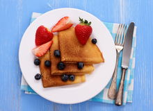 Stack of pancakes, fresh strawberry blueberry, cutlery Royalty Free Stock Photography