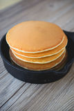Stack of pancakes in frying pan with blackberries and maple syru Royalty Free Stock Photography