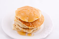 Stack of pancakes with honey Stock Photography