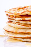 Stack of pancakes with honey Stock Photos