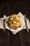 Stack of pancakes with honey,banana and walnuts Stock Photography