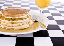 Stack of pancakes with juice Stock Photos