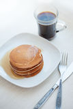 Stack pancakes with maple syrup and Cup of stock image
