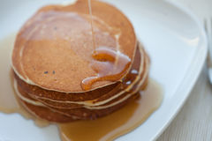 Stack of pancakes with maple syrup, top view stock photo