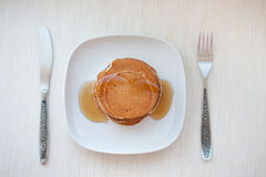 Stack of pancakes with maple syrup, top view stock photos
