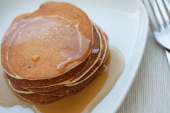Stack of pancakes with maple syrup, top view royalty free stock photos