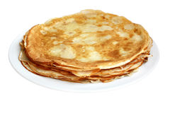 Stack of Pancakes. A stack of pancakes with melted butter and slathered with syrup oozing over the sides Royalty Free Stock Photos