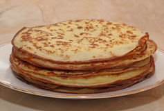 The stack of the pancakes on the plate Royalty Free Stock Photos